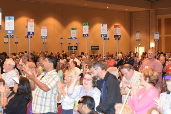 NFB members cheer during the general session of the 2018 National Convention.