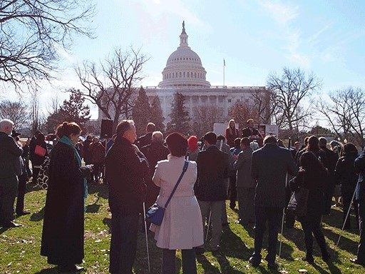 A crowd of NFB members gathers outside near the capitol dome in Washington, DC.