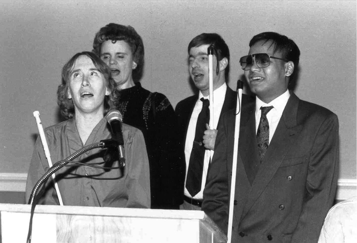 NFB singers at a podium in 1992.