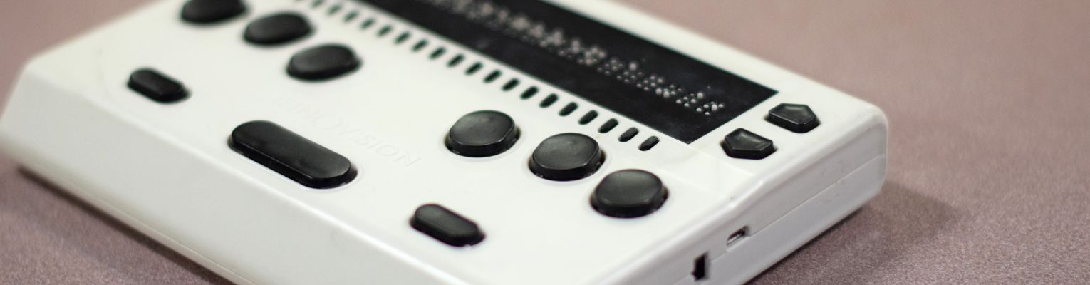 The Innovision Braille Me device rests on a table.