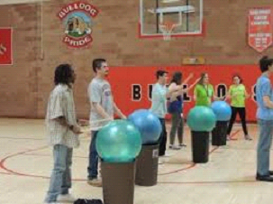 People gather for a cardio drumming class led by Jessica Beecham at the Colorado School for the Deaf and Blind.