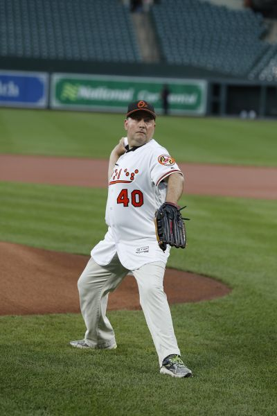 NFB President Mark A. Riccobono wears an Oriole jersey with Braille on it, and stands on the mound at Oriole Park at Camden Yards as he throws the first pitch.