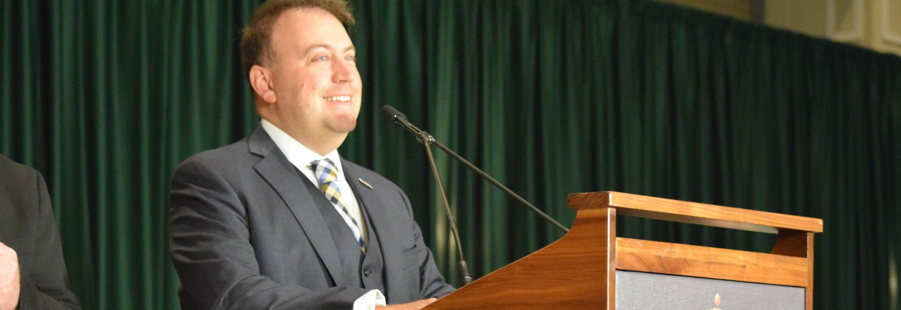 NFB President Mark A. Riccobono stands at the podium as he delivers an address during our national convention.
