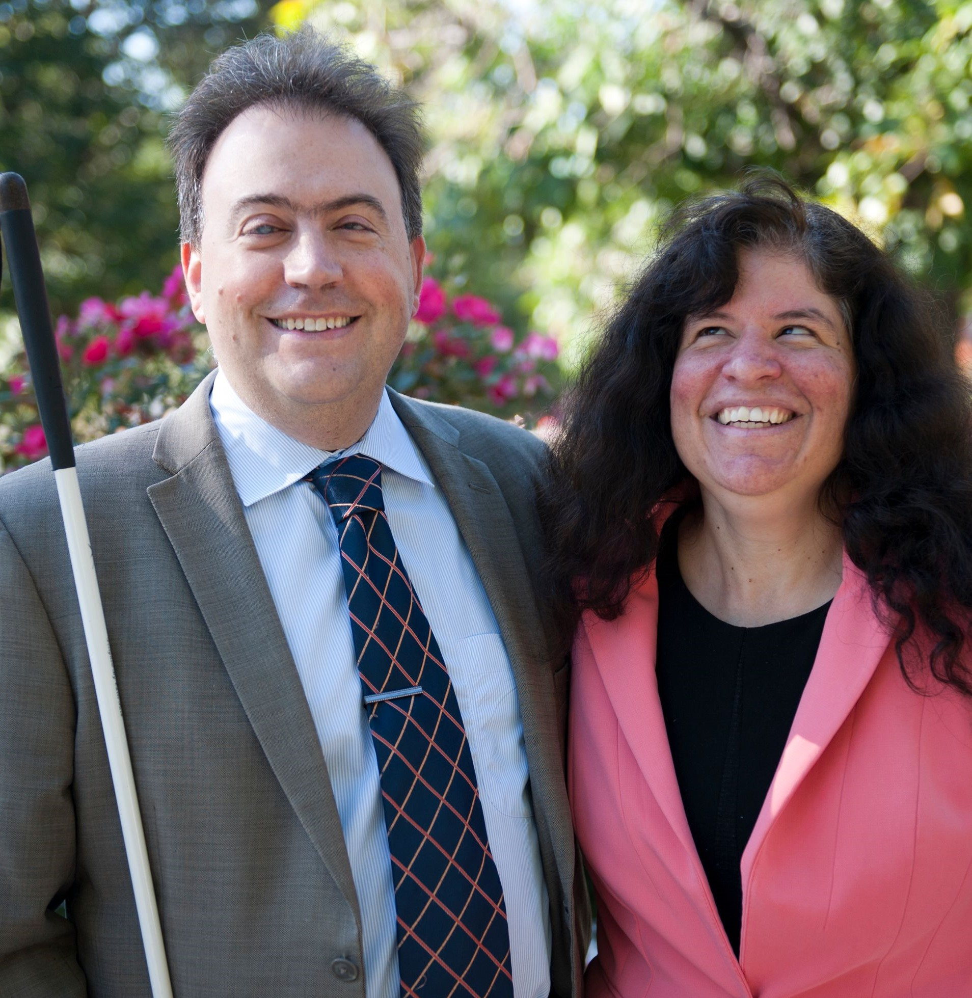 NFB President Mark A. Riccobono and First Lady Melissa Riccobono stand together smiling in the park.