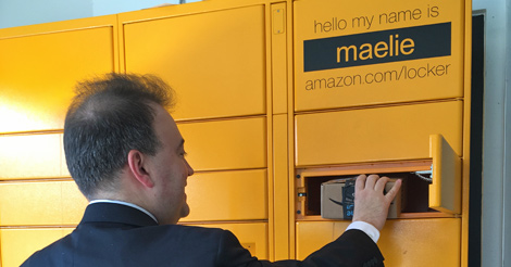 Mark Riccobono opens a box to retrieve his package from an Amazon Locker.
