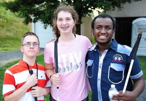Brent, Molly, and Abdi smile with their canes for a photo at NFB Youth Slam Rec-X.