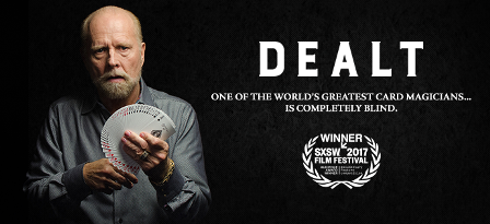 """Dealt movie poster featuring Rick with a deck of cards fanned out in his hands with the words """"Dealt. One of the world's greatest card magicians... is completely blind. SXSW Film Festival Winner 2017"""""""
