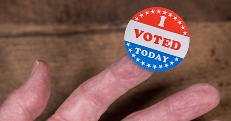 """An """"I Voted Today"""" sticker rests on a person's finger."""