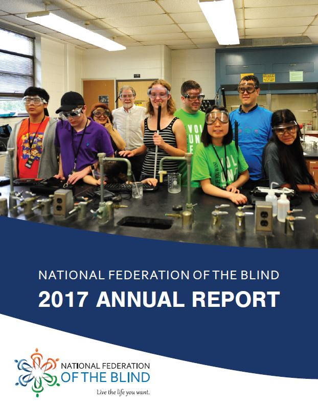 Cover of the 2017 annual report showing a group of blind students smiling in a chemistry lab with their goggles on.