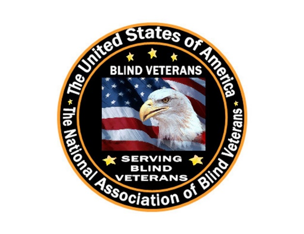 "A round seal with the words ""The United States of America - The National Association of Blind Veterans"" on the outer edge of the circle. In the center of the seal is a waving American Flag with an image of a bald eagle looking to the left. The words ""Blind Veterans"" are above the flag, with three yellow stars above the words. The words ""Serving Blind Veterans"" are below the flag, with one yellow star on each side."