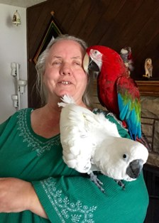 Yolanda Thompson with her parrots