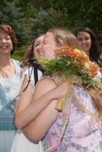 Arielle and KJ hug at Arielle's wedding