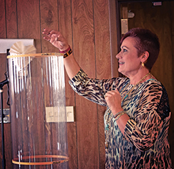 NFB STEM2U teacher participant tests self-made recyclable aircraft in a wind tunnel