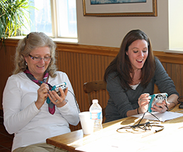 Teachers tracking the temperature of their glasses using accessible science tools.