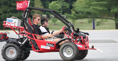 A blind Youth Slam student drives a modified dune buggy with the help of the blind driver challenge modifications.