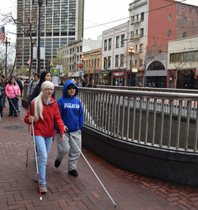 Blind students travel independently with their long white canes on a visit to San Francisco.