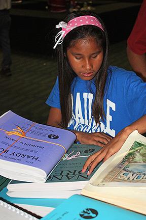 Taengkwa Sturgell examines books at the Braille Book Fair