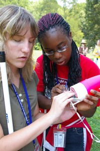 Two girls inspect a rocket at the 2011 NFB Youth Slam