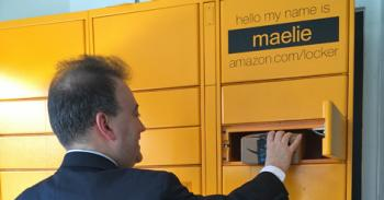 Mark Riccobono opens a box to retrieve his package from an Amazon Locker.