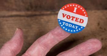 "An ""I Voted Today"" sticker rests on a person's finger."