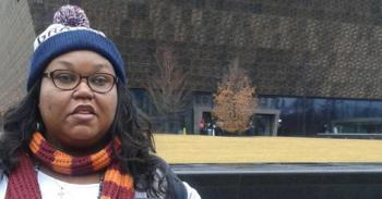 Marilyn Green in front of the National Museum of African American History and Culture in Washington DC.