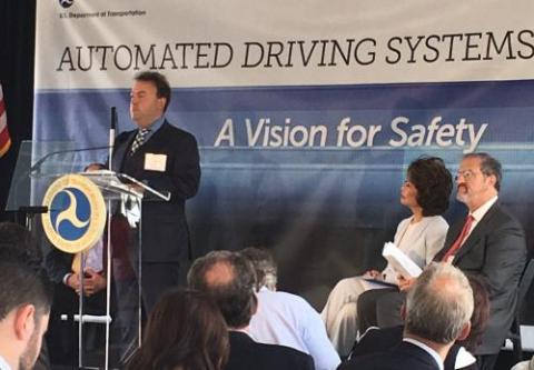 President Mark Riccobono stands at a podium to address the crowd at USDOT's Vision for Safety event.