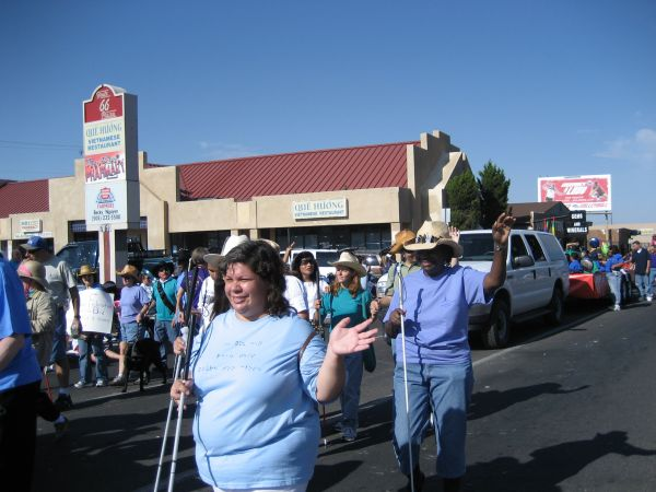 Blind people walk in a parade in New Mexico during Meet the Blind Month.