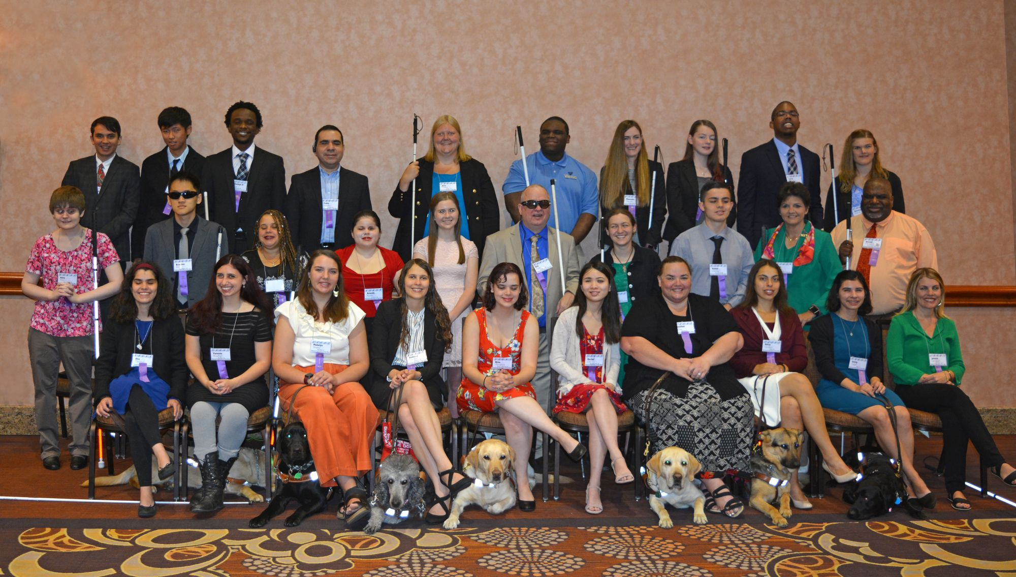 2019 scholarship winners sit for a group photo at the NFB National Convention in Las Vegas.