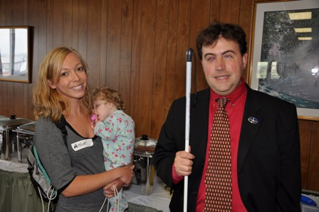 Mark Riccobono visiting with a parent from the conference and her blind daughter.