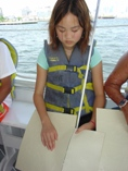A girl examines a tactile map of the ocean depths.