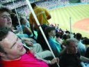 Blind people enjoying a MLB baseball game.