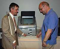 Steve Booth, Access Technology Specialist at the NFB, works with a blind voter.