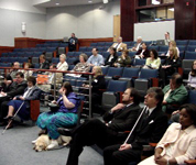 Participants in the GAMA Summitt listen to a presentation in the Jernigan Institute Auditorium.