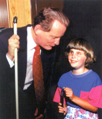 Marc Maurer with a blind child.