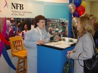 First Lady of the Federation, Pat Maurer, offers brochures and forms to Possibilities Fair attendees.