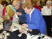 Seniors explore low vision aids for sale.