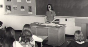 A blind woman, Dolores Reisinger, teaches her students.