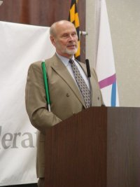Jim Omvig speaks at the 2006 Possibilities Fair for Seniors.