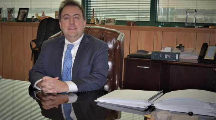 NFB President Mark A. Riccobono sits at his desk at the national headquarters.