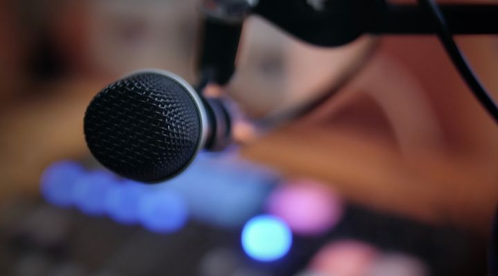 microphone and soundboard with blurred background