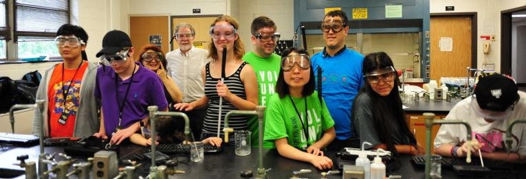 Blind students pose for a photo during a science class.